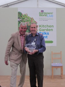 Arthur receiving the bowl from TV gardener Jim Buttress